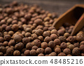Allspice on a gray wooden background, close-up 48485216