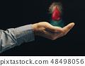 Human hand blood drop. World Blood Donor Day. 48498056