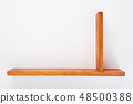 wooden shelf at white background texture 48500388