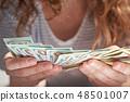 Closeup of a woman hands count us dollar money 48501007