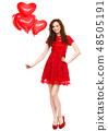 Young woman holding heart-shaped balloons 48505191