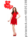 Young woman holding heart-shaped balloons 48505198