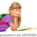 Little girl is reading a book 48505685