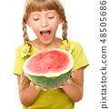Little girl is eating watermelon 48505686
