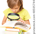 Little girl is reading book 48505744