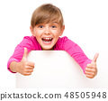 Little girl is looking out from the blank banner 48505948