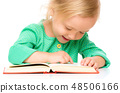 Little girl is reading her book 48506166