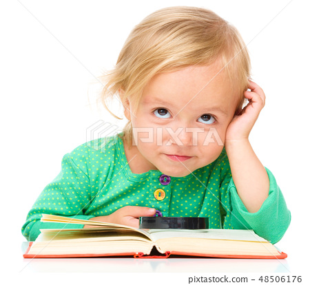 Little girl is reading her book 48506176
