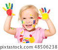 Portrait of a cute little girl playing with paints 48506238