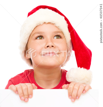 Little girl in santa hat is holding blank board 48507041