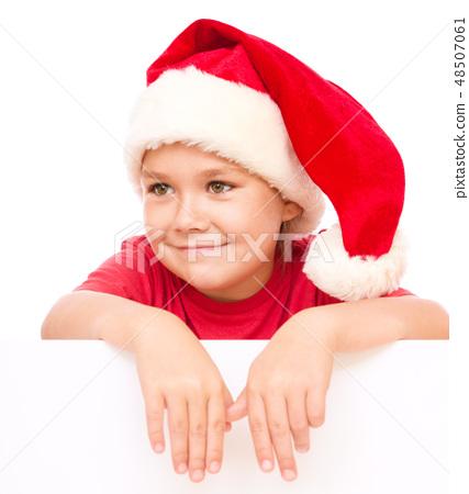Little girl in santa hat is holding blank board 48507061
