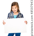 Little girl is holding a blank banner 48507943