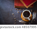 Black coffee in white cup and old books. 48507995