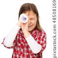 Cute little girl is looking through spyglass 48508169