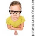 Portrait of a little girl wearing glasses 48508720
