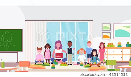 woman teacher teaching mix race boys and girls preschool modern kindergarten children classroom with 48514538