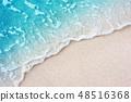 Soft blue ocean wave on clean sandy beach 48516368