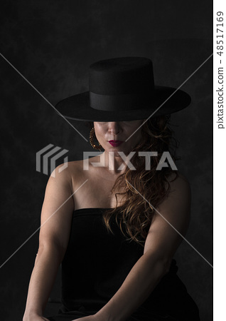 girl with black spanish hat 48517169