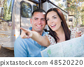 Young Couple Holding Map In Front of New RV 48520220