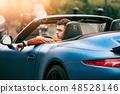 Succesful man drives luxury convirteble sport car 48528146