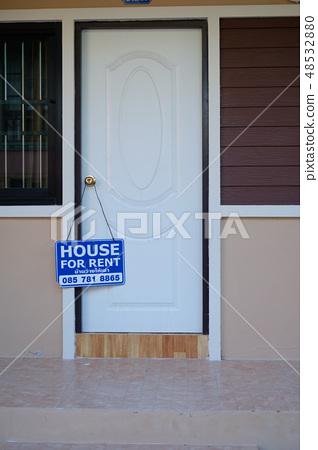 Door with a  rental house board 48532880