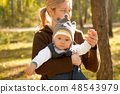Baby Boy or Girl Have Fun Outdoors 48543979