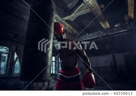 Hand of boxer over black background. Strength, attack and motion concept 48550013