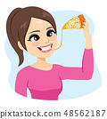 Young Woman Enjoying Eating Melted Cheese Pizza 48562187