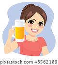 Young Girl Smiling Holding a Beer Pitcher Cheering 48562189
