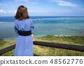 이시가키 섬의 平久保 곶에 서 여성 48562776