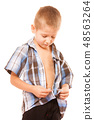 little boy buttoning on shirt, isolated on white 48563264