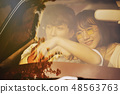 Romantic scene of young couple sweet love in car 48563763
