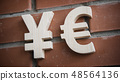Exchange currency Yen, Euro on a brick wall 48564136