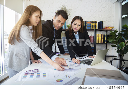 Business people working together in office. 48564943