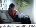 Mother holding a baby child rearing neurosis postpartum depression 48564966