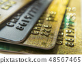 Gold and platinum credit cards close up 48567465