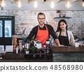 Portrait business owner couple wear apron 48568980
