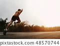 man runner start running on road 48570744