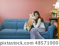 asian woman holding  her dog 48571000