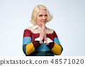 Senior  woman   having mournful facial expression 48571020