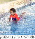 Cute Asian boy playing in swimming pool 48573596