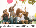 kids playing outdoors 48576281
