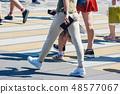 pedestrians at a pedestrian crossing 48577067