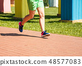legs of girl running in a sports competition 48577083