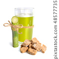 Sugar cane juice with brown sugar. Isolated 48577735