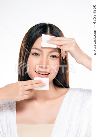 young beautiful woman cleaning face by cotton. 48584860