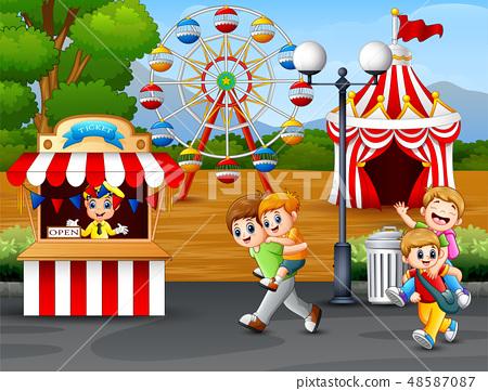 Happy kids having fun in an amusement park 48587087