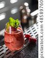 Cocktail drink frozen raspberries daiquiri. 48589760