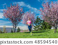 Woman having fitness run in the spring sun 48594540