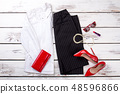 Flat lay female clothes and accessories. 48596866